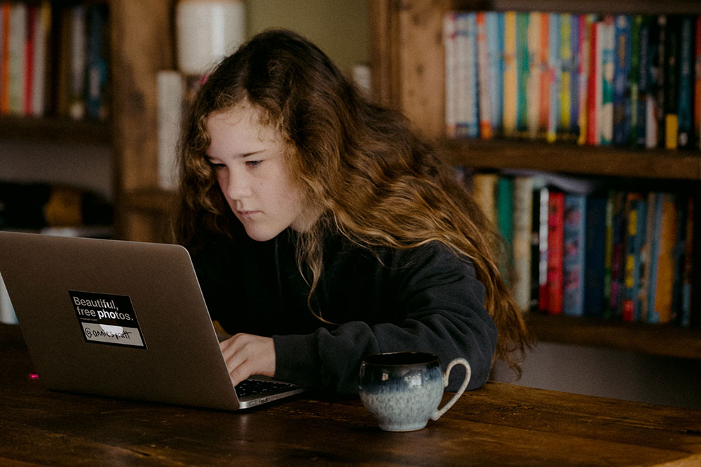Image of a kid on laptop